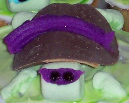 Close up of a ninja turtle cupcake